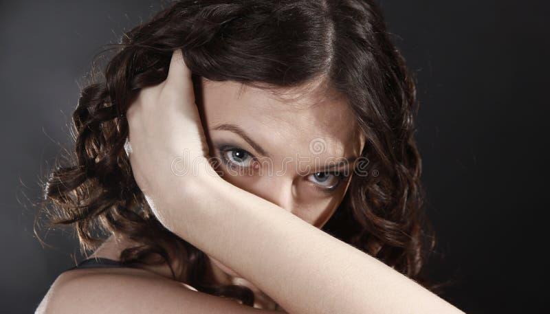 Closeup .emotive portrait of a beautiful young woman stock photography