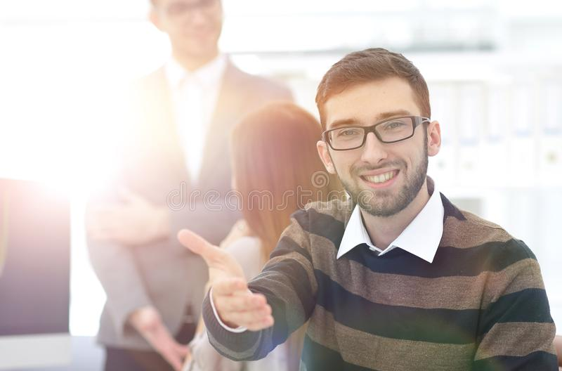 Closeup.employee showing thumb up. Closeup.the employee sitting in the office and showing thumb up royalty free stock images