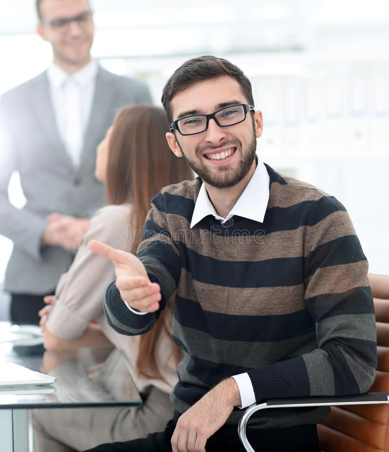 Closeup.employee showing thumb up. Closeup.the employee sitting in the office and showing thumb up royalty free stock photography