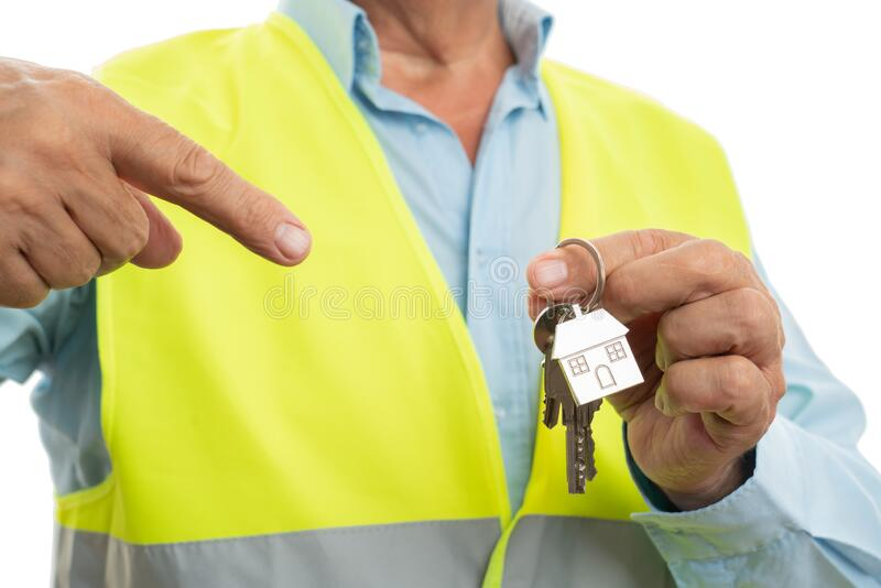 Closeup of engineer pointing at keys stock photography