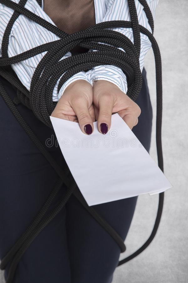 Closeup of an envelope in the hand of a business woman. Bribe royalty free stock image
