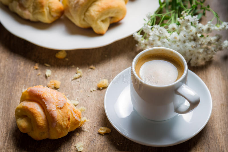 Closeup of espresso and croissant for breakfast royalty free stock image