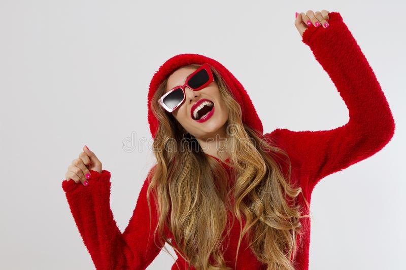 Closeup excited screaming young woman. shock, Shocked girl in red hoodie. Wow, surprised female. Fashion sweatshirt  royalty free stock photography