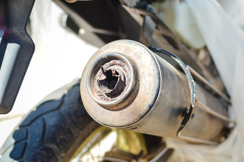 Closeup on exhaust of motobike royalty free stock photo