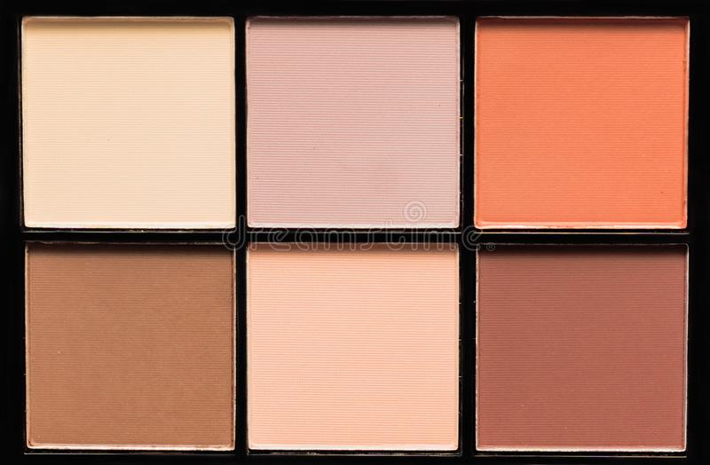 Closeup of eyeshadow palette. makeup woman beauty fashion. Nude shades, matt texture stock photography