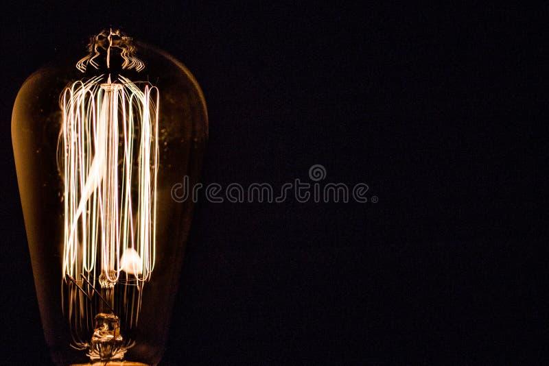 Closeup för ljus kula med isolerad svart bakgrund royaltyfri fotografi