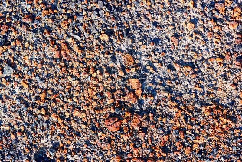Closeup för textur för smutsjordkiselstenväg royaltyfri foto
