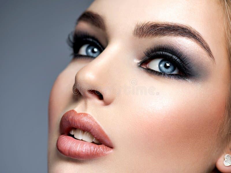 Closeup face with fashion makeup stock photos