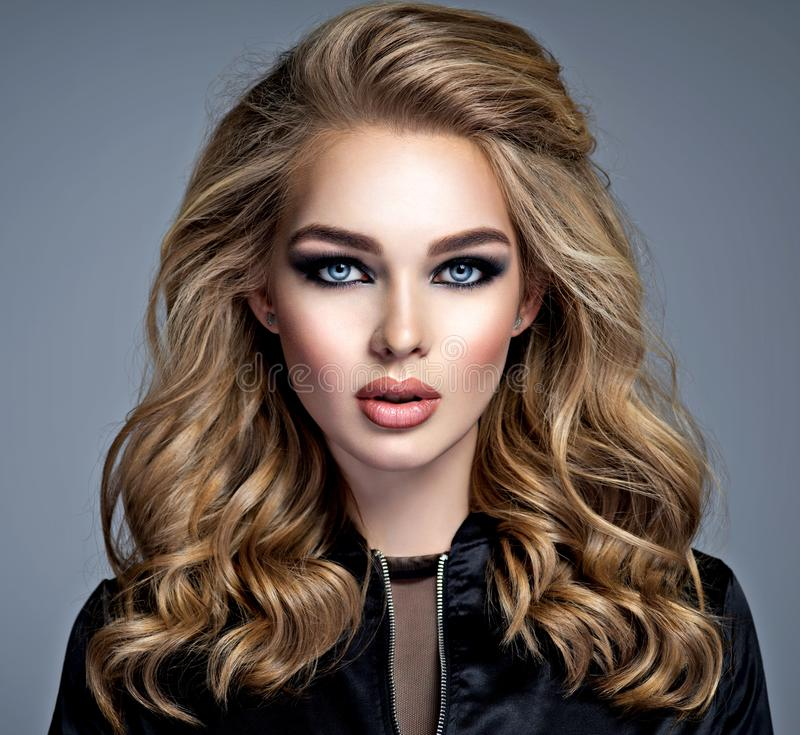 Beautiful blonde girl with makeup in style smoky eyes. stock photos