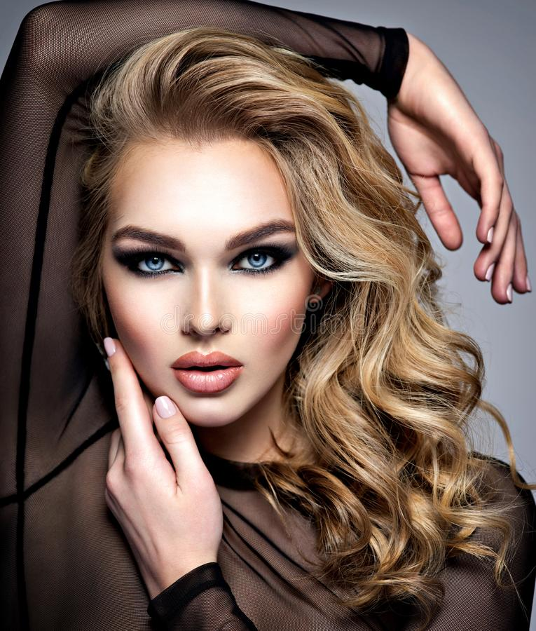 Closeup face of a beautiful girl with  makeup in style smoky eyes stock images