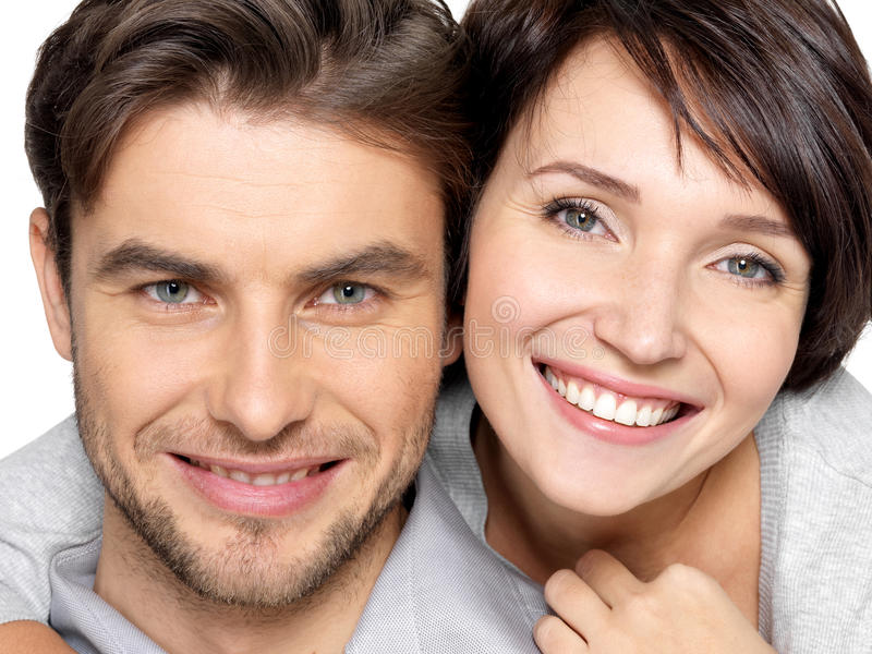 Closeup face of beautiful happy couple - isolated stock photos