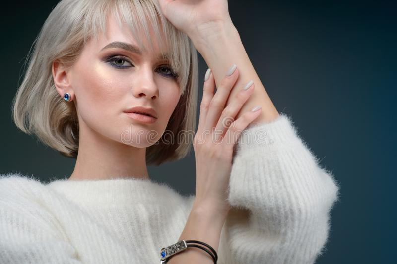 Closeup face of beautiful woman with smoky eyes make-up and light lipstick. Portrait of an attractive girl in the studio royalty free stock images