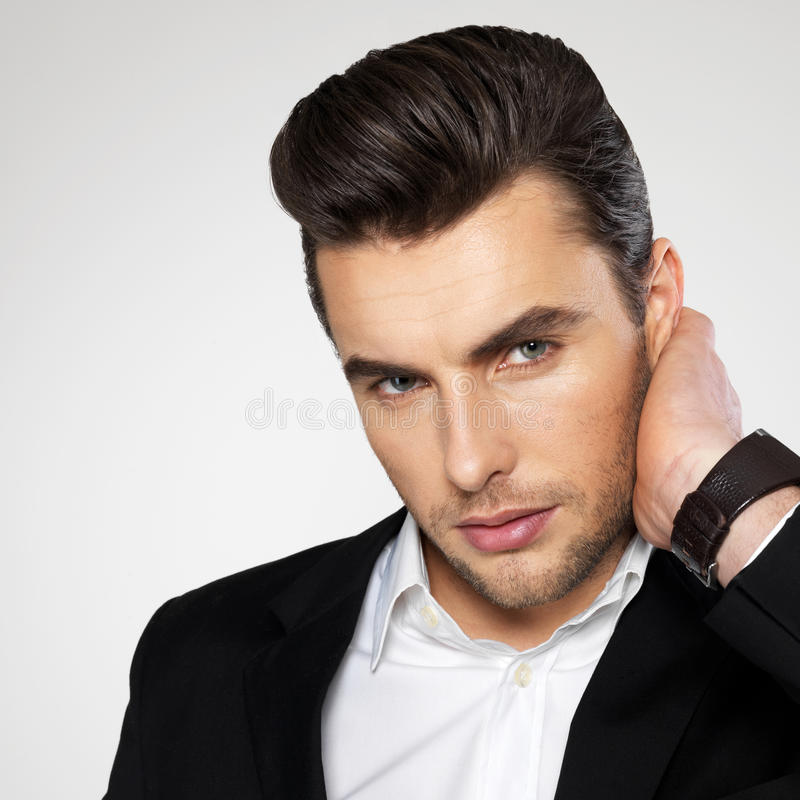 Closeup face of a fashion businessman in suit stock photo