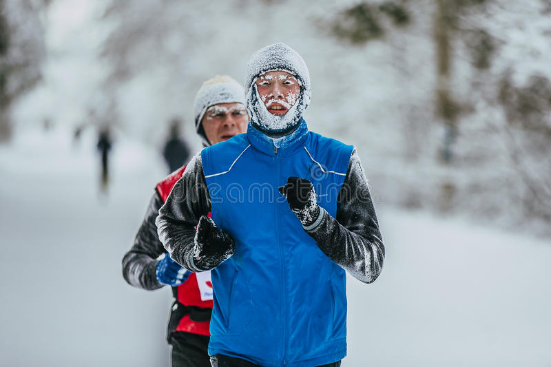 Closeup face in frost of young athlete runner royalty free stock images