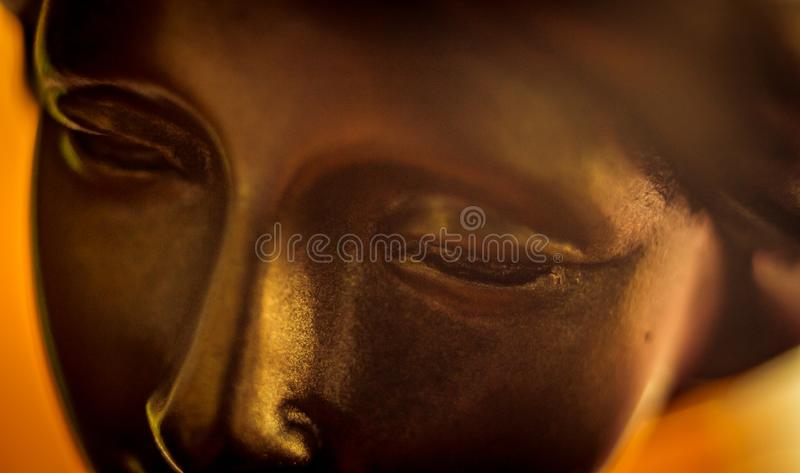Closeup on face of gold statuette royalty free stock photos