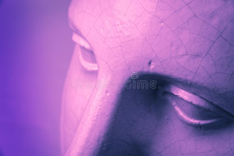 Closeup face gypsum copy antique sculpture with craquelure. Pink purple vintage filter effect. Eyes. Close up face gypsum copy antique sculpture with craquelure royalty free stock image