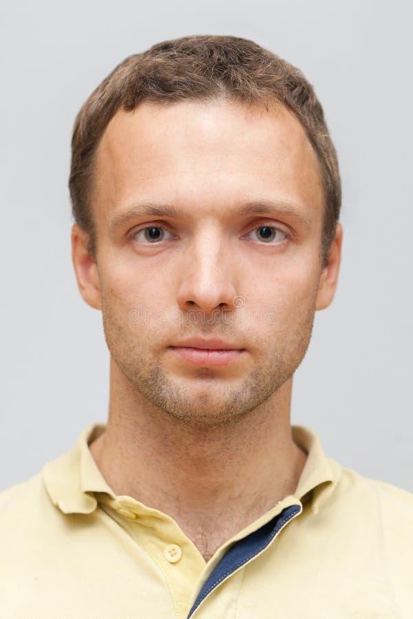 Closeup face portrait of young Caucasian man stock photos