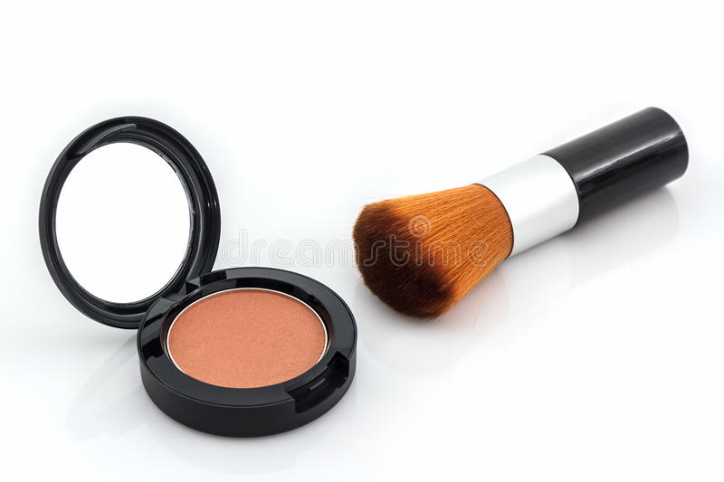 Closeup of face powder and makeup brush. stock image