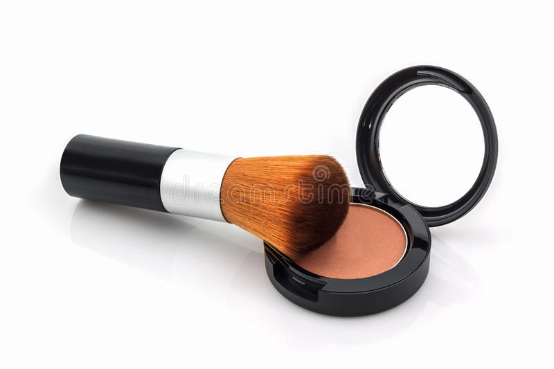 Closeup of face powder and makeup brush. stock photos