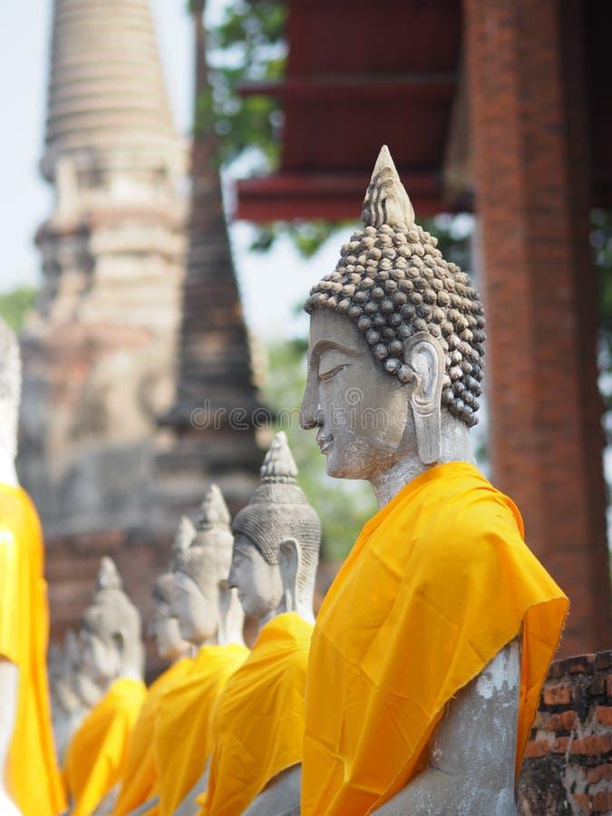 Stucco Buddha images in the Ayutthaya period enshrined at the Wat Yaichaimongkol, Buddhist Temple. Closeup face Stucco Buddha images in the Ayutthaya period stock photo