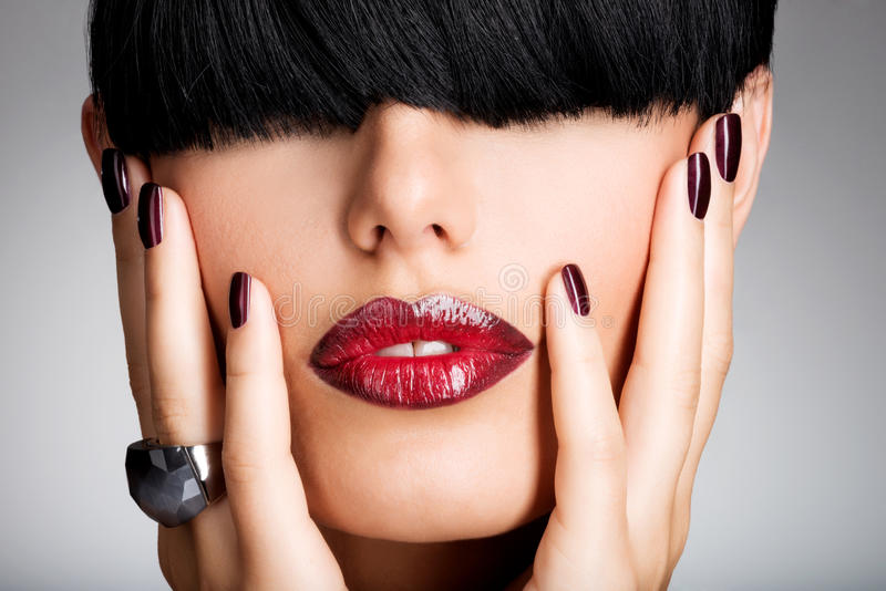 Closeup Face Of A Woman With Beautiful Red Li Stock Images