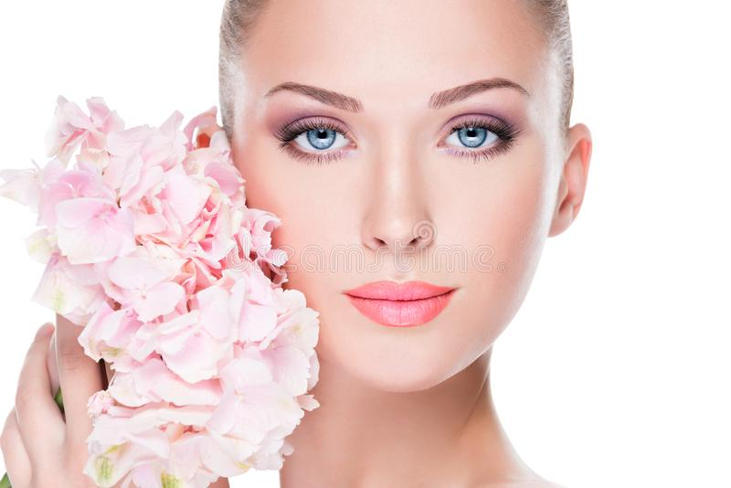 Closeup face of young beautiful woman with a pink makeup of eyes royalty free stock images