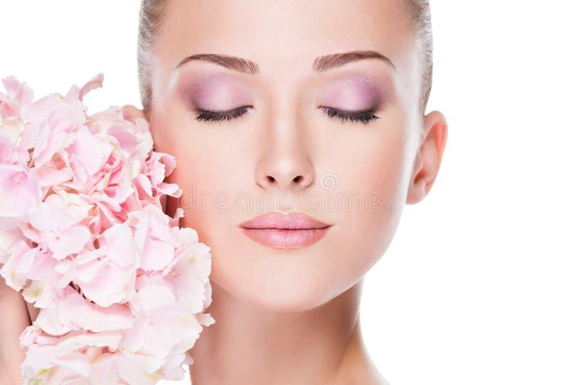 Closeup face of young beautiful woman with a pink makeup of eyes stock image