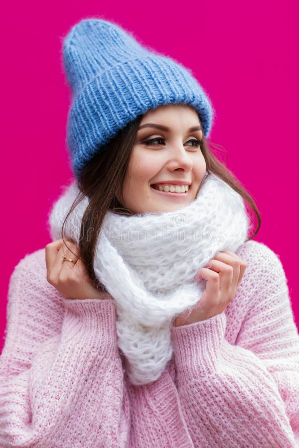 Closeup face of a young Smiling woman enjoying winter wearing knitted scarf and hat. stock images
