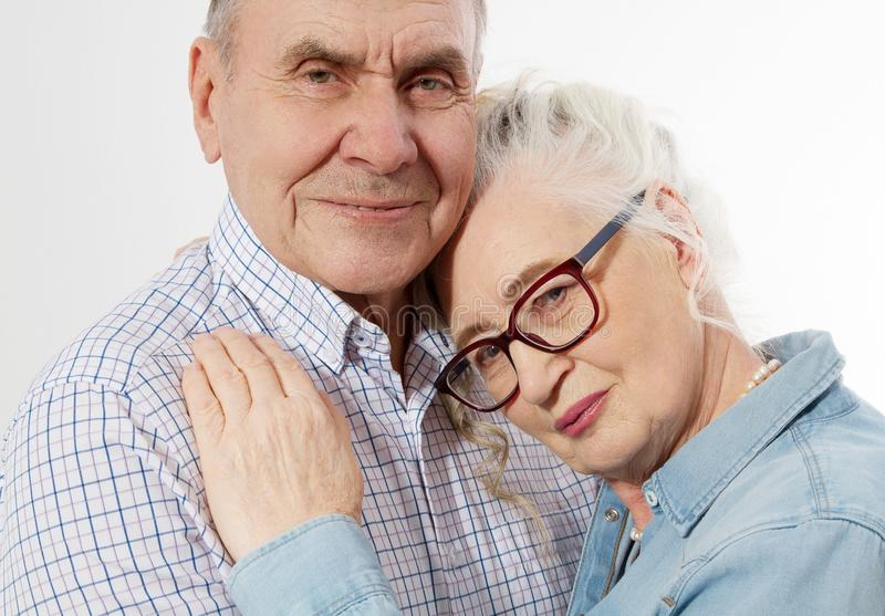 Closeup faces. Happy senior family couple isolated on white background. Close up portrait woman and man with wrinkled face. royalty free stock photo