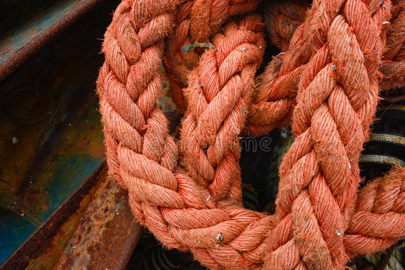Closeup of faded and partly worn segments of thick pink rope royalty free stock photo