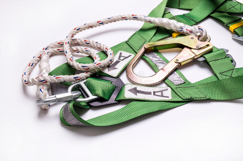 Closeup fall protection Hook harness and lanyard for work at heights. On white background stock photography