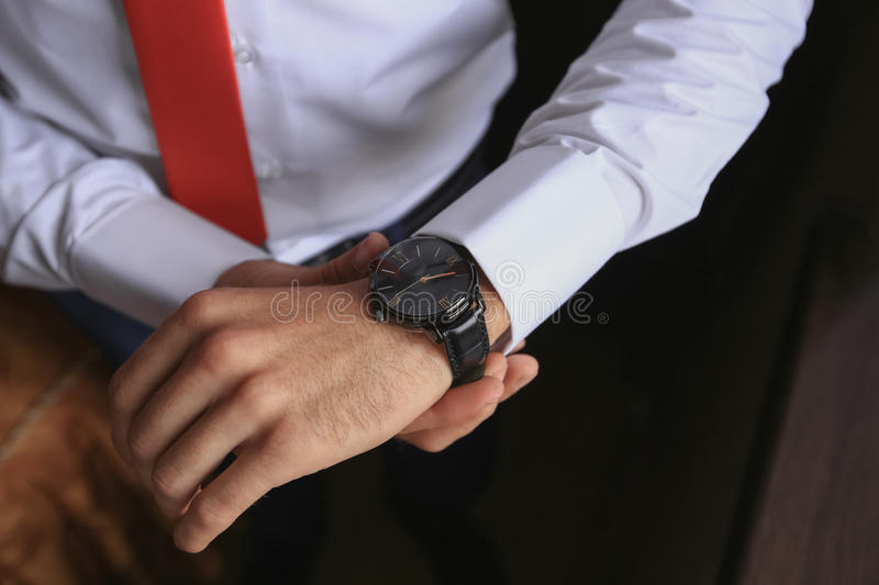Closeup fashion image of luxury watch on wrist of man. body detail of a business man. Man's hand royalty free stock image