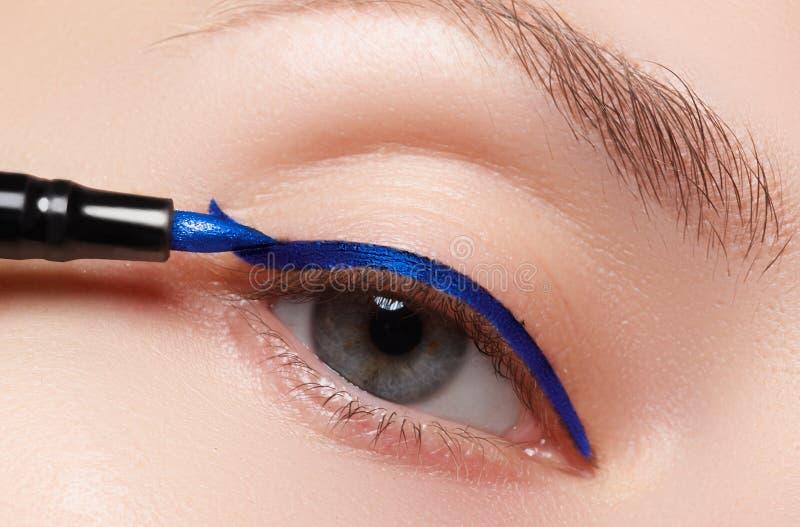 Closeup fashion makeup. Perfect face skin, extreme long eyelashes. And metallic arrow make up. Retro make-up stock photos