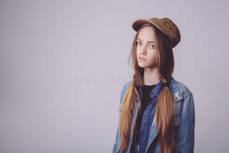 Closeup fashion studio portrait of hipster young tender girl stock photos