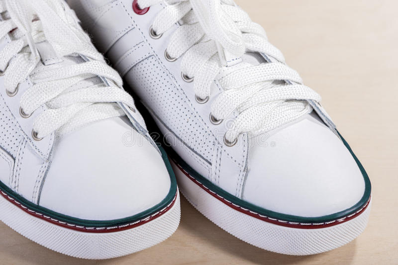 Closeup of Fashionable Modern Laced Sneakers in Whit. E. Horizontal Image Composition stock photography