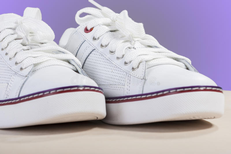 Closeup of Fashionable Modern Laced Sneakers in White. Horizontal Image Composition royalty free stock photos
