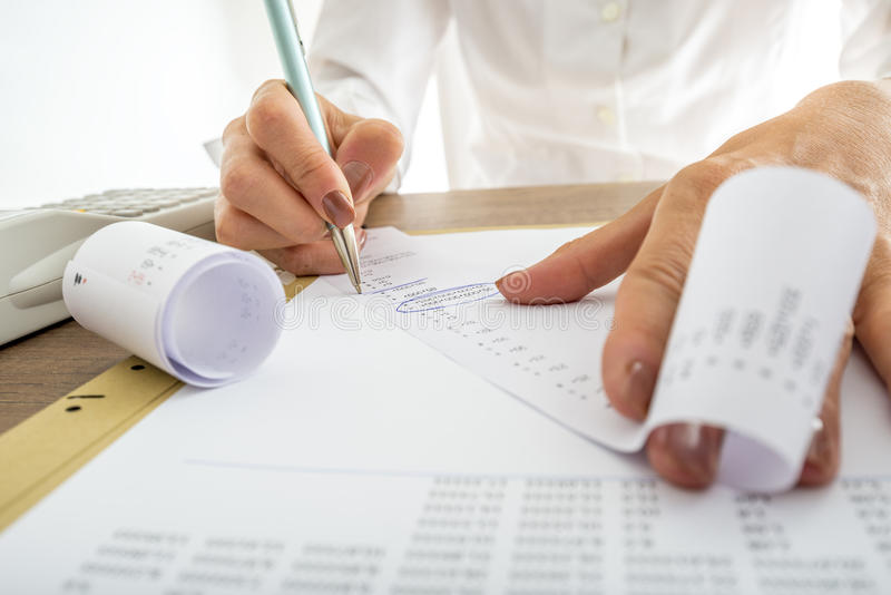 Closeup of female accountant looking through the receipts royalty free stock photos