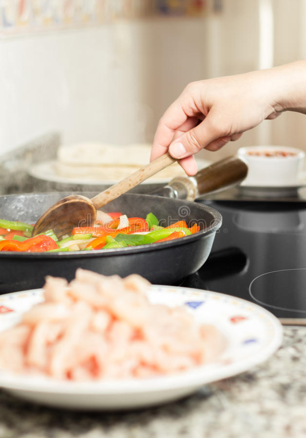 Closeup Of Female Cooking Vegetables And Chicken In A Pan Royalty Free Stock Image