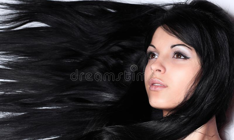 Closeup of a female face. on black. stock images
