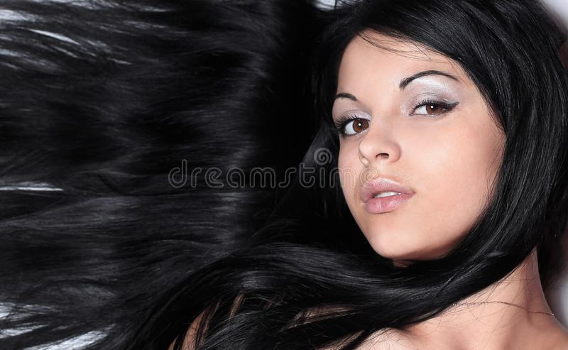 Closeup of a female face. on black. stock image