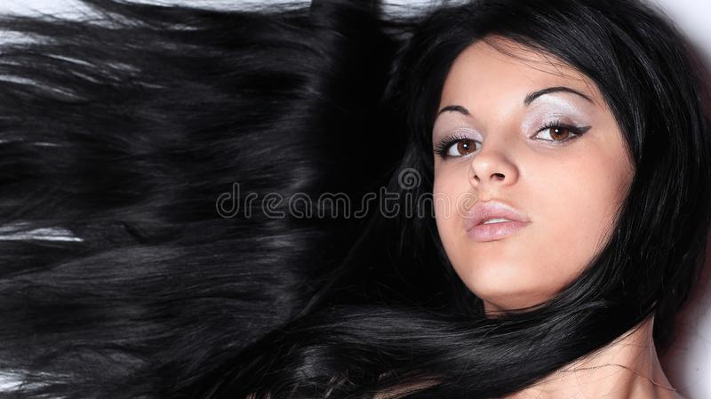 Closeup of a female face. isolated on black. royalty free stock image