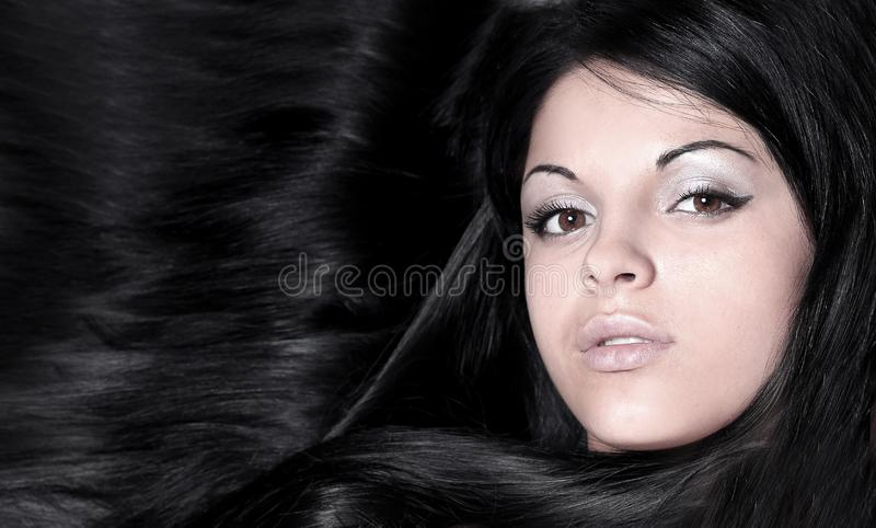 Closeup of a female face. isolated on black. stock images