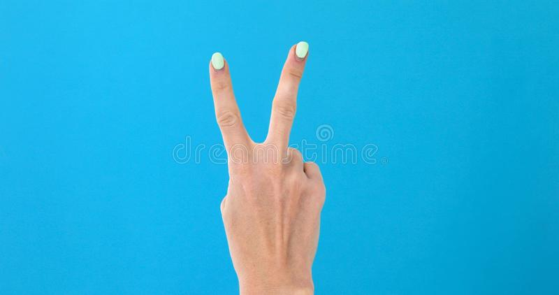 Closeup female hand counting from 0 to 5 royalty free stock photography