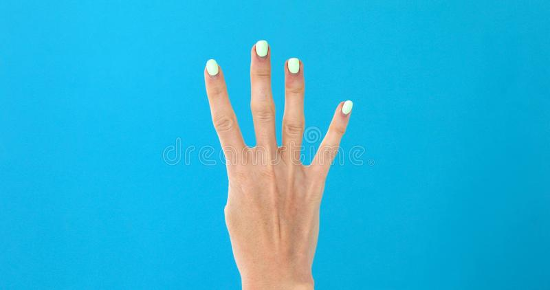 Closeup female hand counting from 0 to 5 stock photography