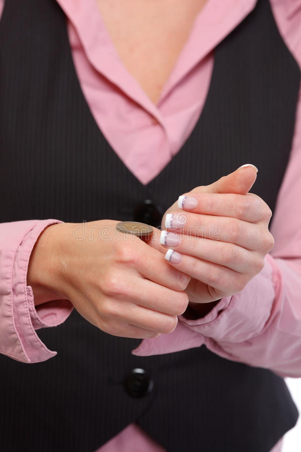Closeup on female hand opening tossing coin result royalty free stock image