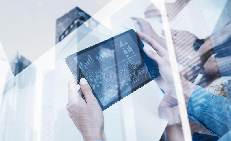 Closeup of female hands holding modern electronic tablet.Concept business people using mobile gadgets.Icon and diagramm. On the display.Double exposure stock photo