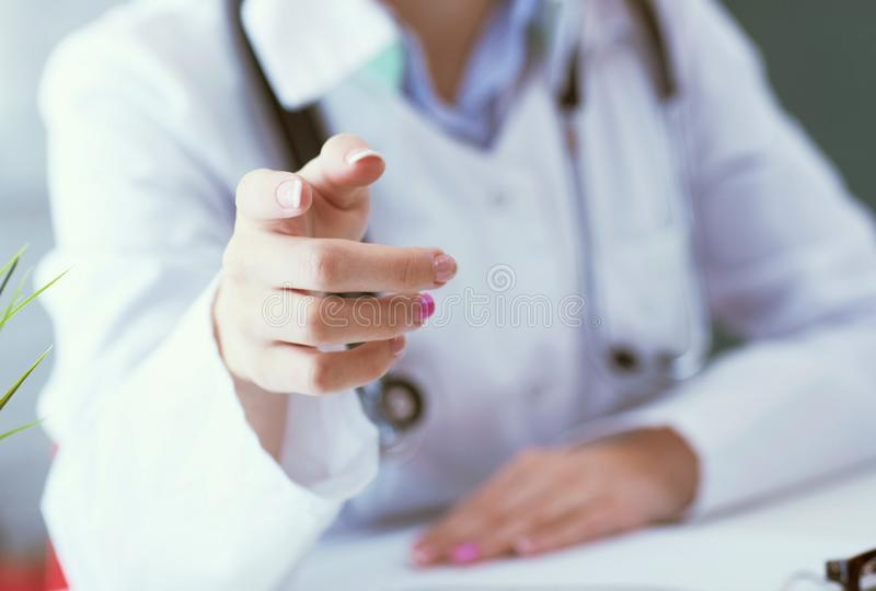 Closeup female health care professional, woman doctor pointing finger, you did something wrong. stock image