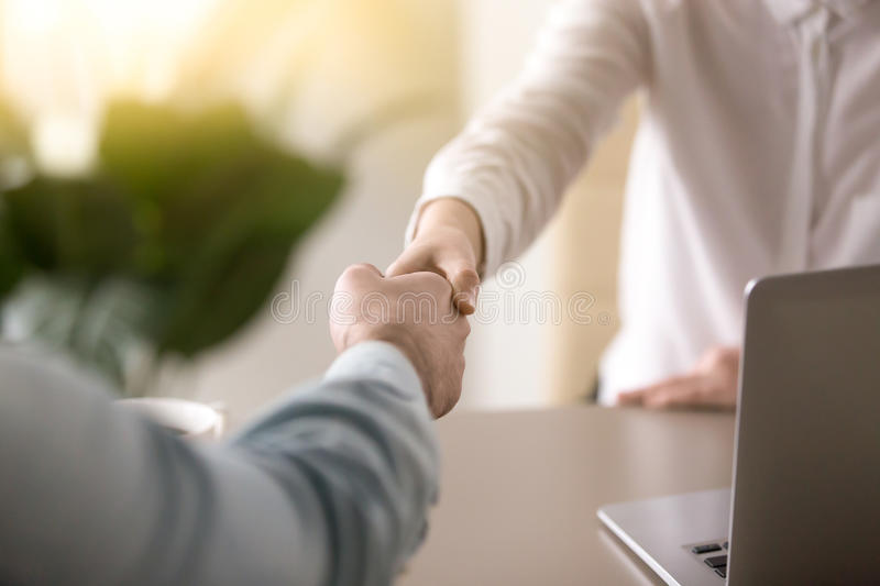 Closeup of female and male hand shaking, business partnership co royalty free stock photo