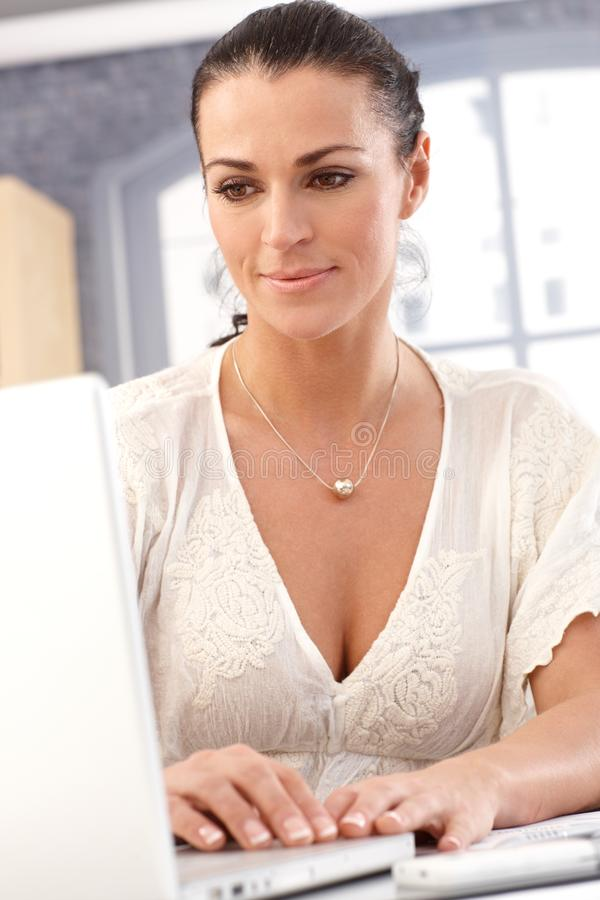 Closeup of female office worker with computer stock photo