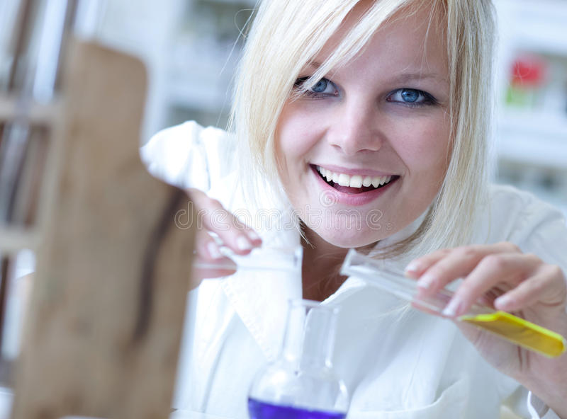 Closeup of a female researcher. Carrying out experiments in a lab royalty free stock photo